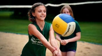 young girl passing a volleyball
