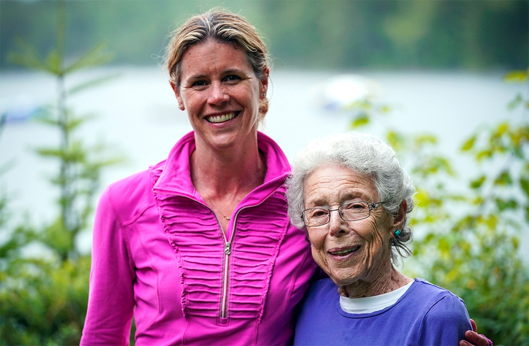 a woman and an older woman smiling