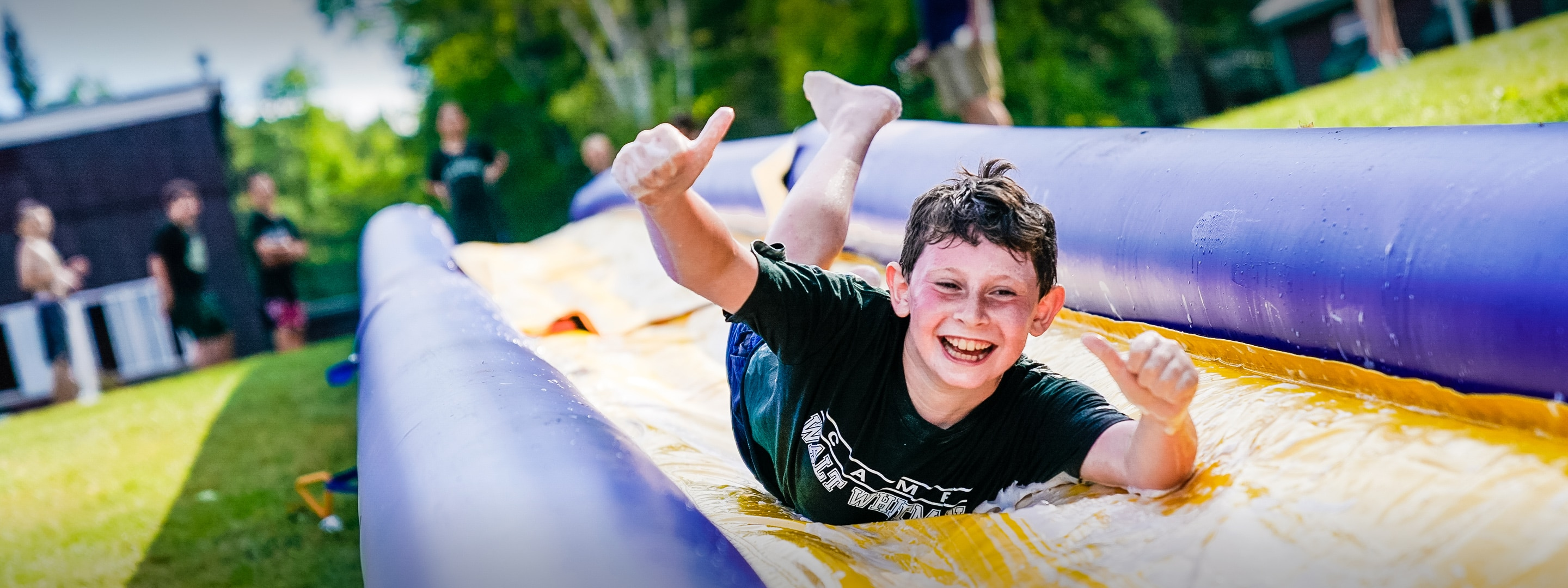boy sliding on a slip and slide