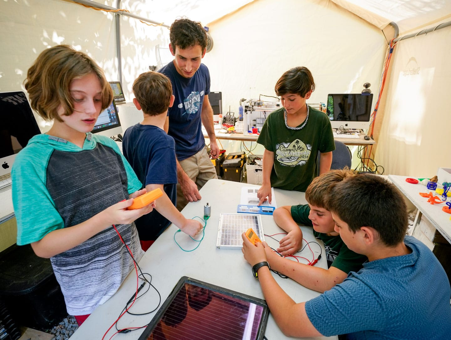 young campers playing with circuits