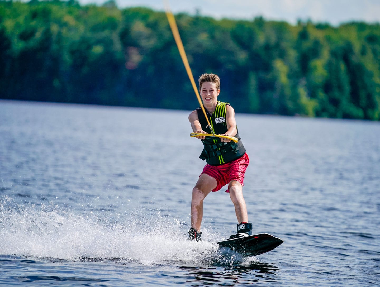 young boy water skiing