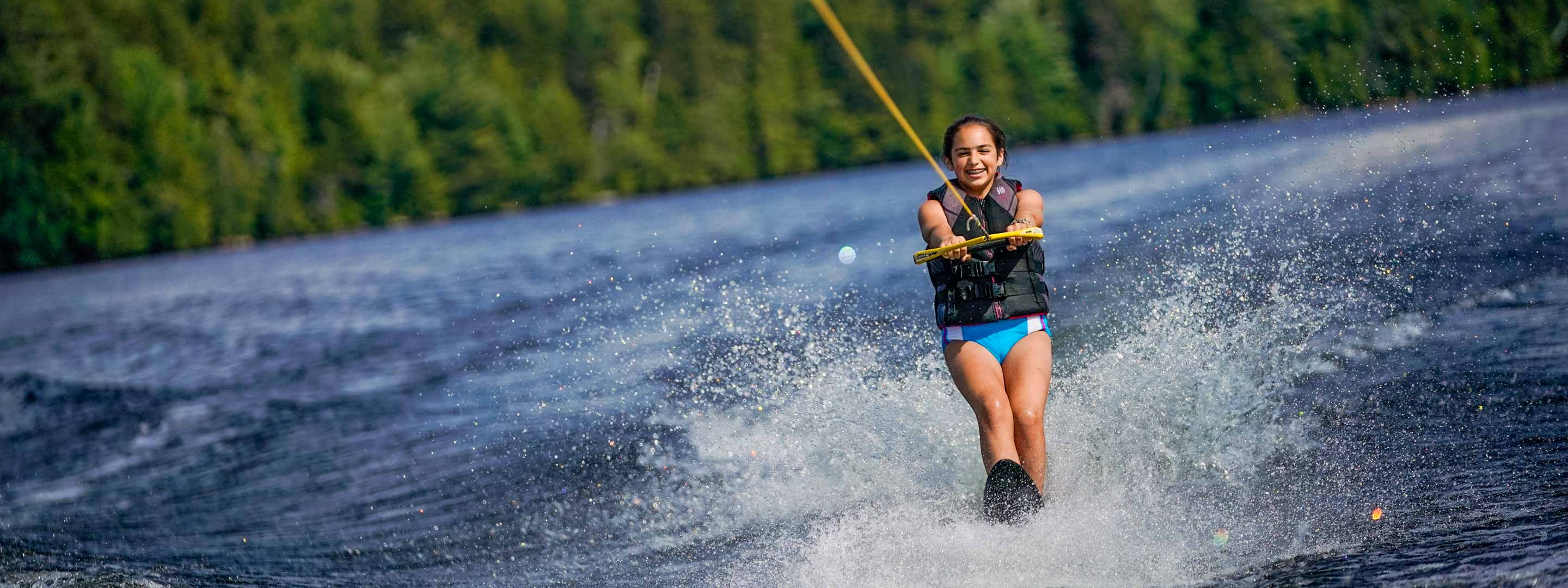 young girl waterskiiing