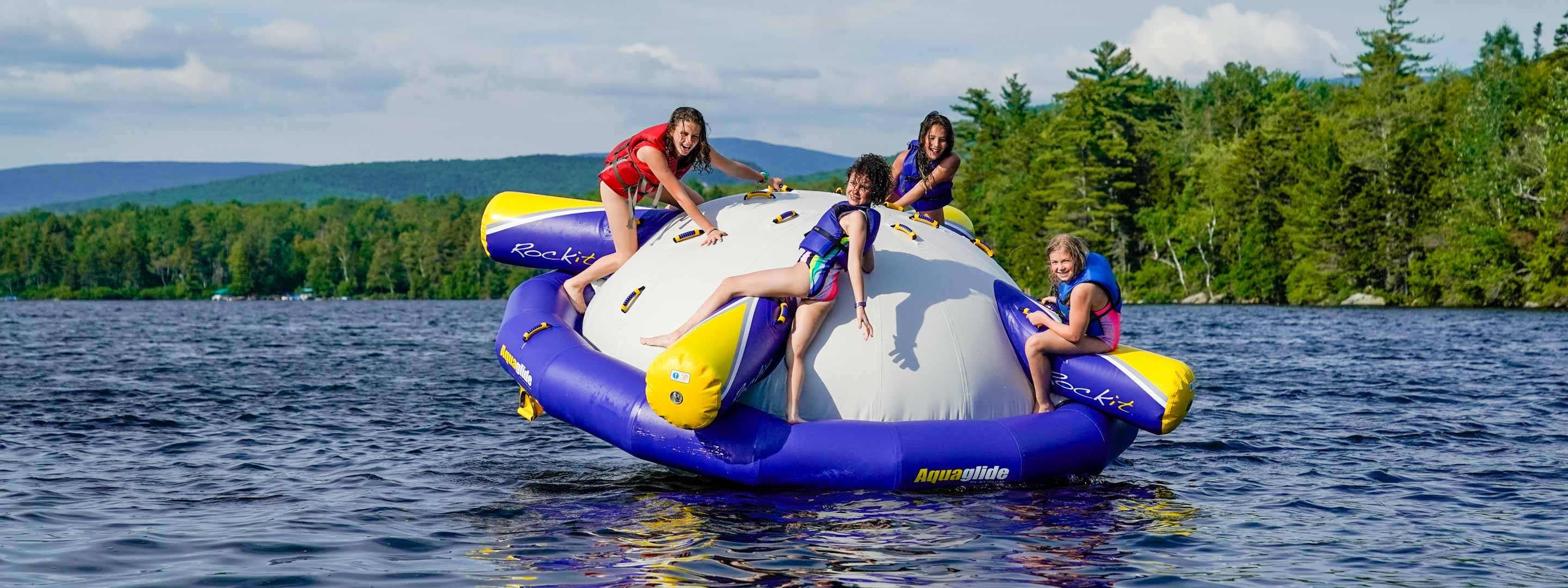 four girls on a wibit on a lake