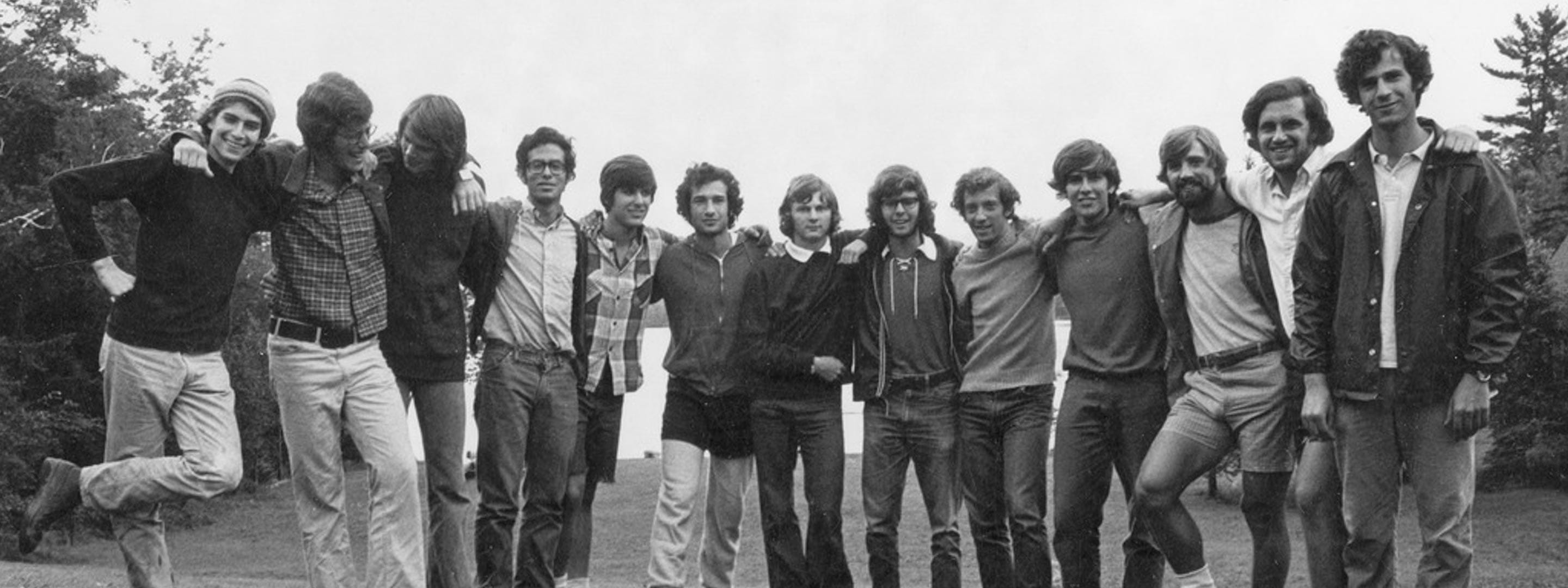 black and white picture of group of young men holding arms