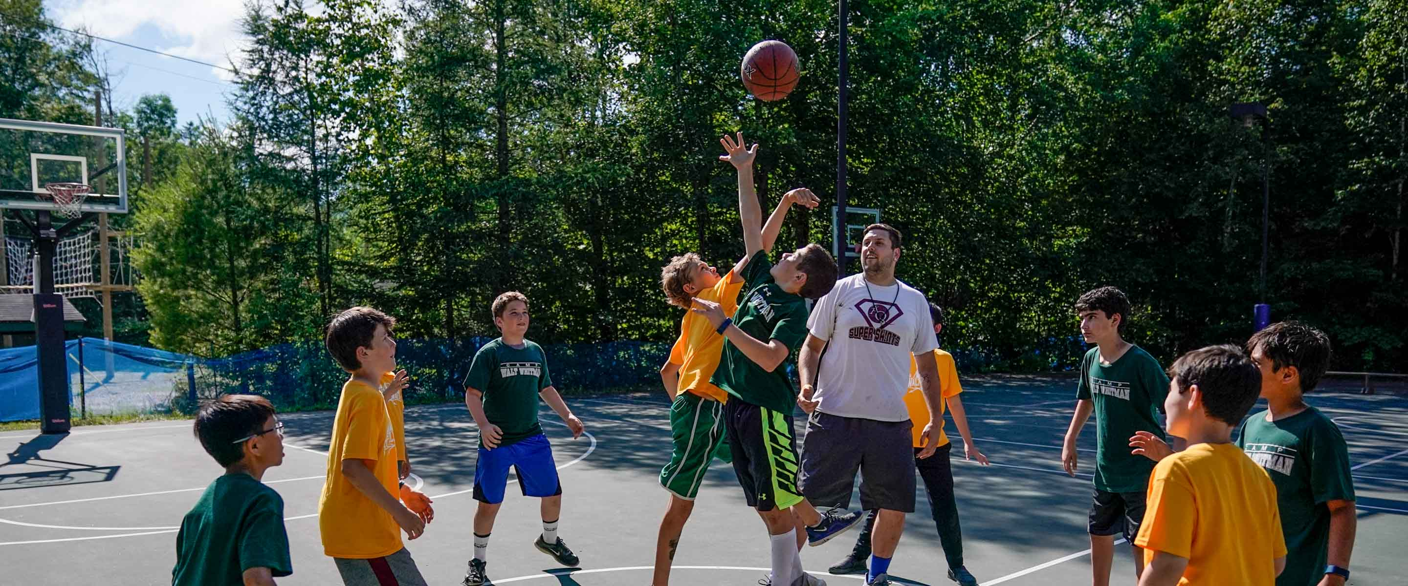 a group of campers playing basketball