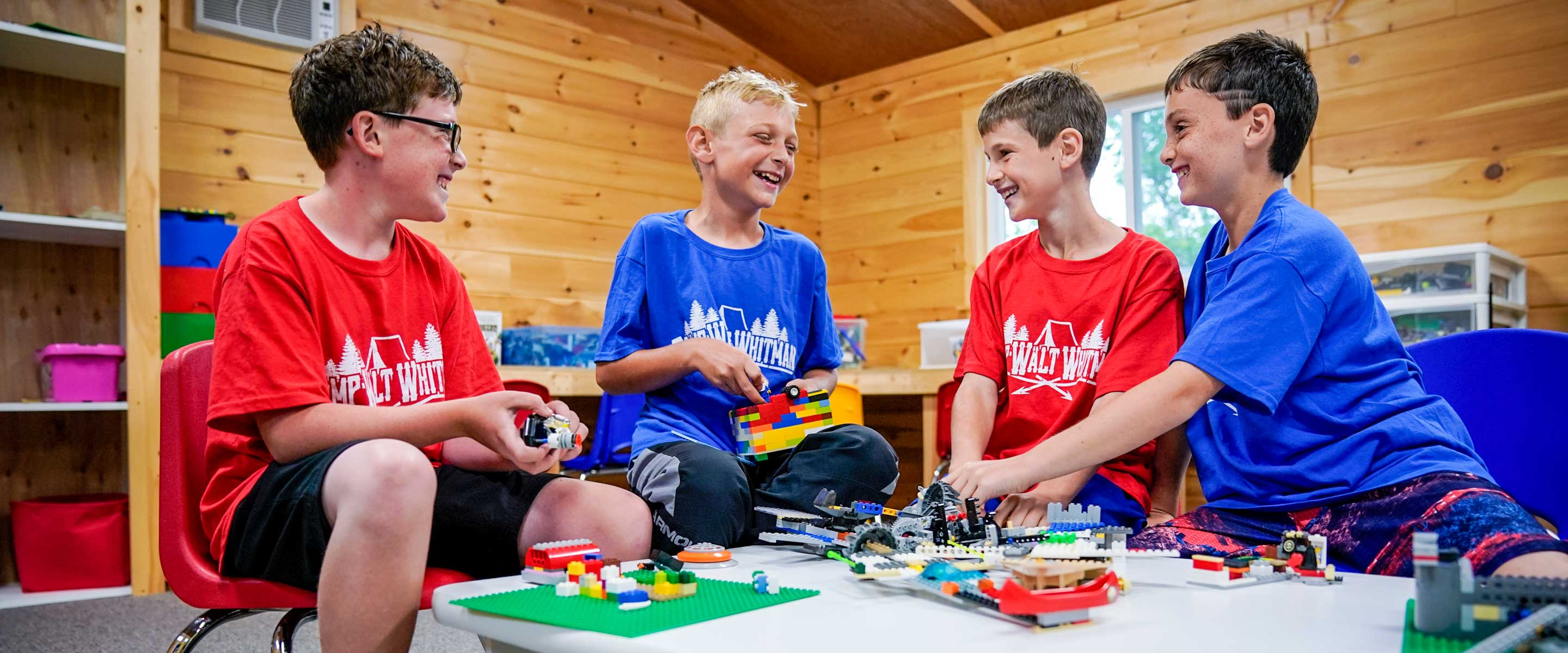 a group of four boys playing with legos