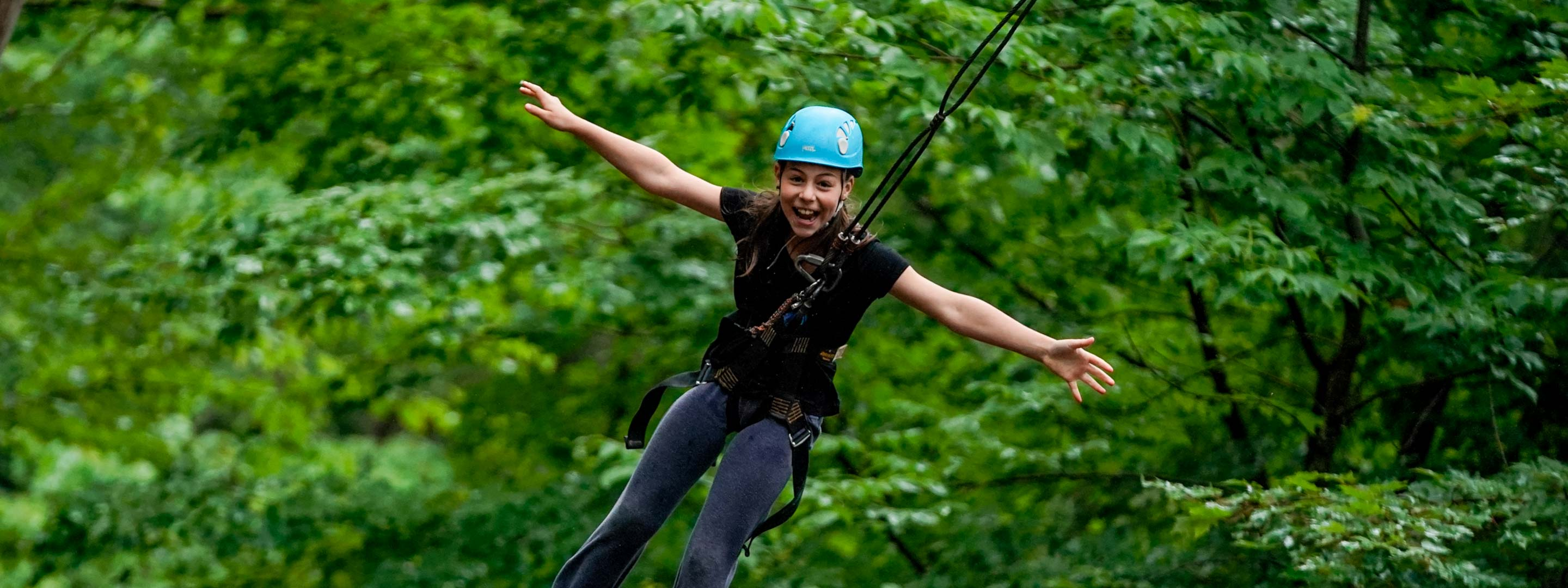 girl smiling while ziplining