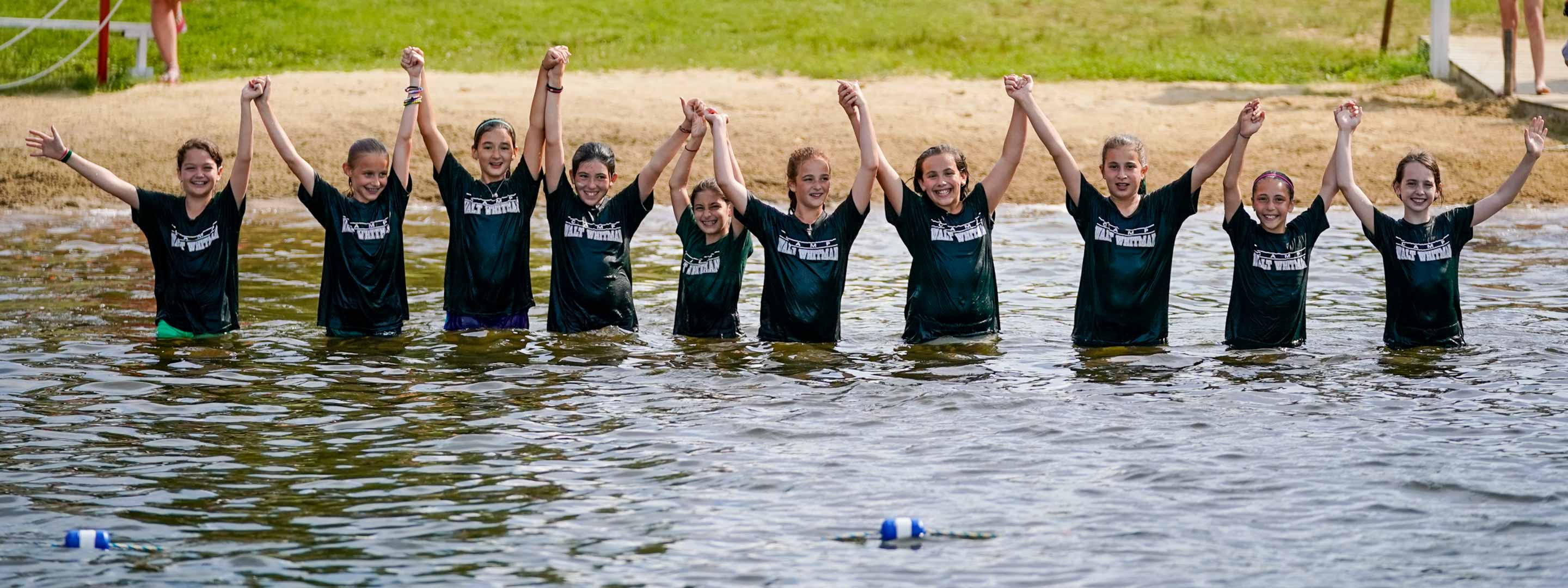 a group of young girls waist deep in water