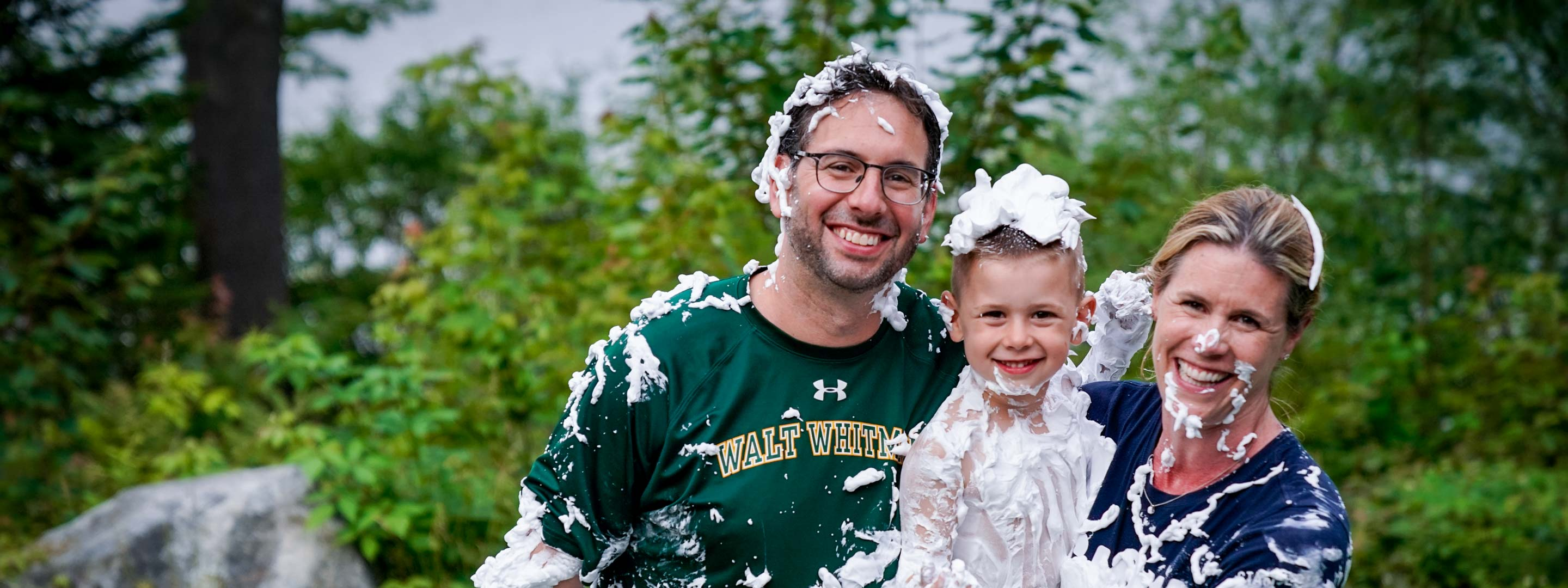 jed dorman with a woman and child covered in whipped cream