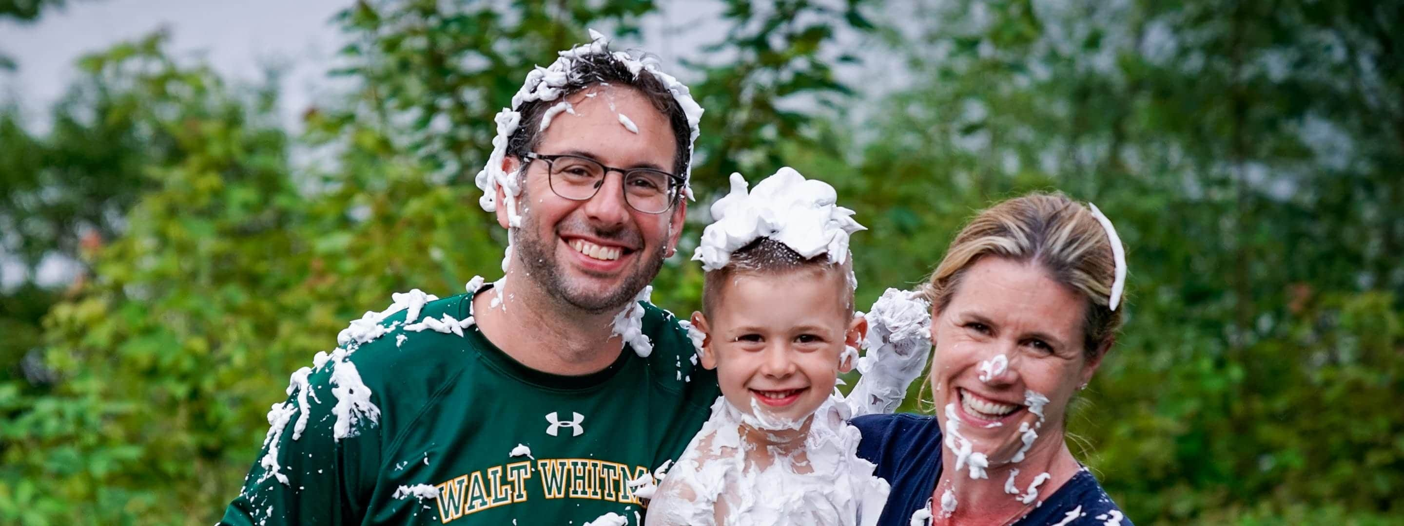 jed dorfman and wife and son covered in shaving cream