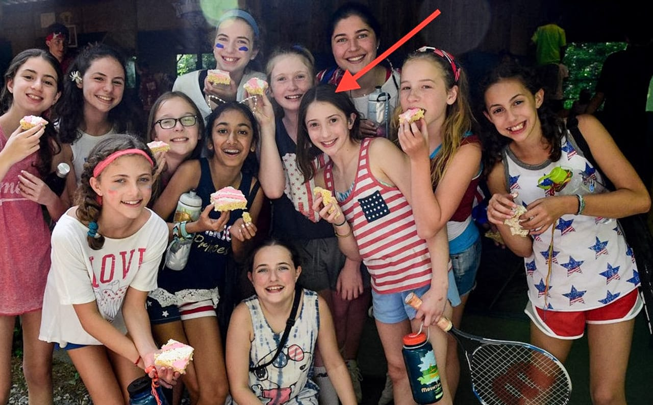 group of young girls eating cake