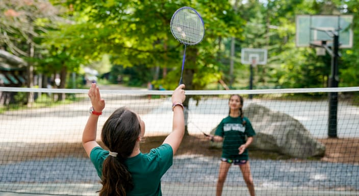 two campers playing badminton