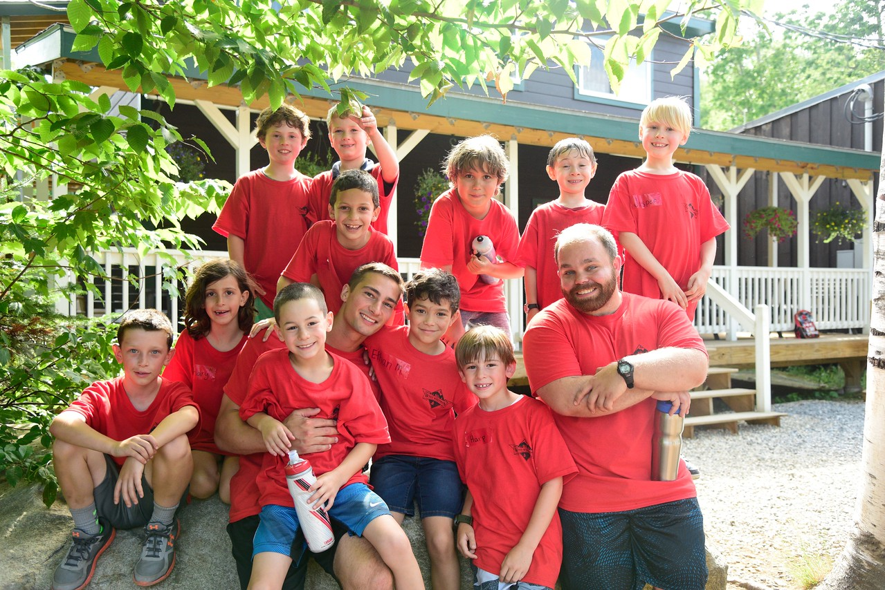 campers and counselors in red shirt smiling