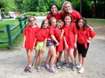 group of campers and counselors in red