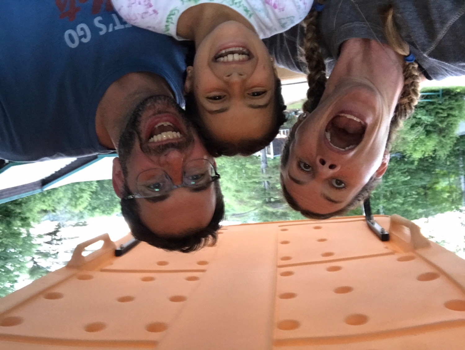 three people with crazy faces smiling upside down
