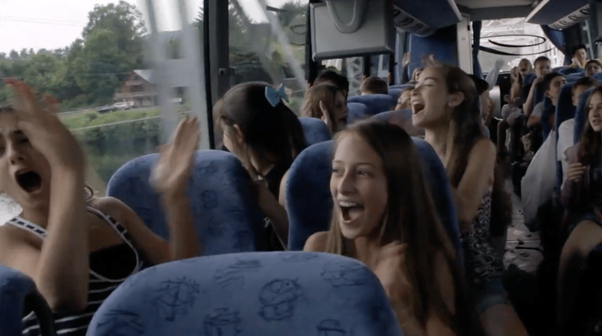 a bus full of happy girl screaming
