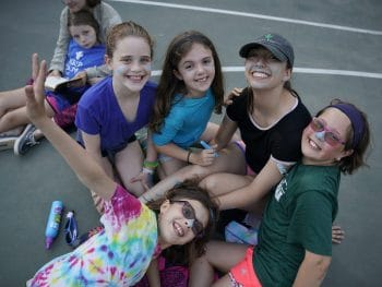 Friends playing together at Camp Walt Whitman