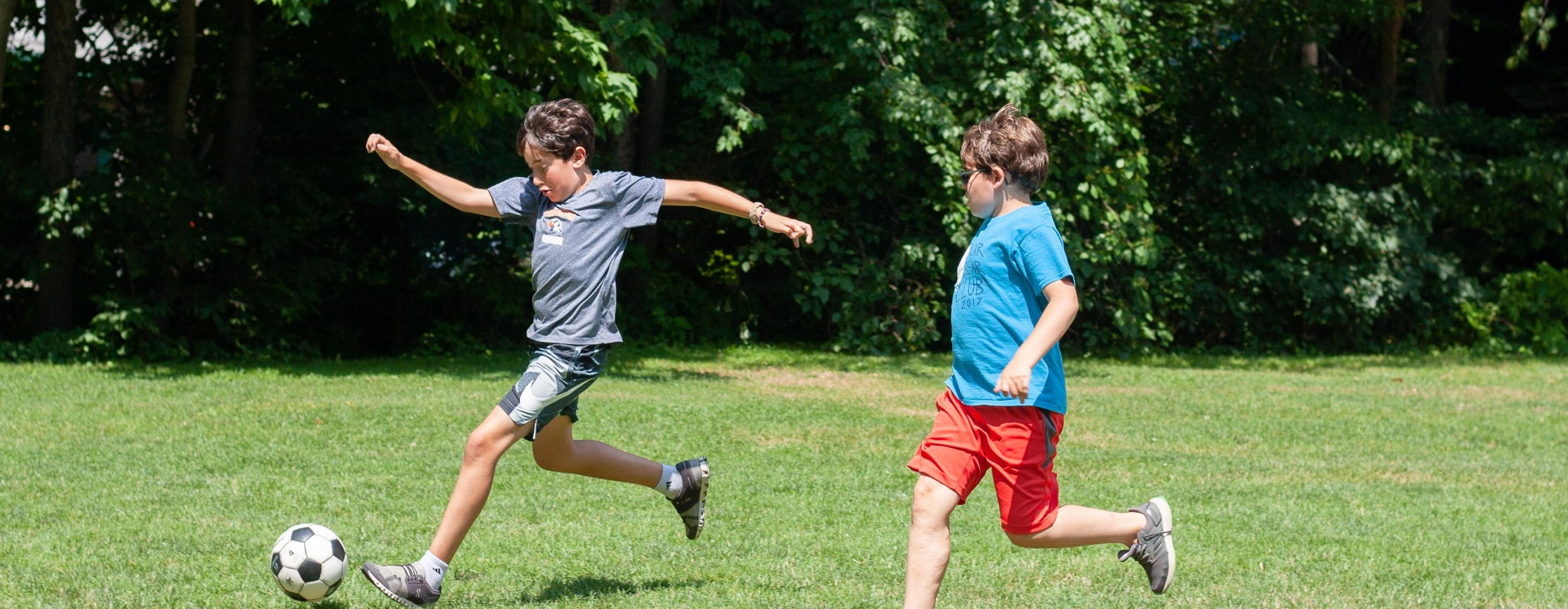 Kids Playing Soccer at Camp