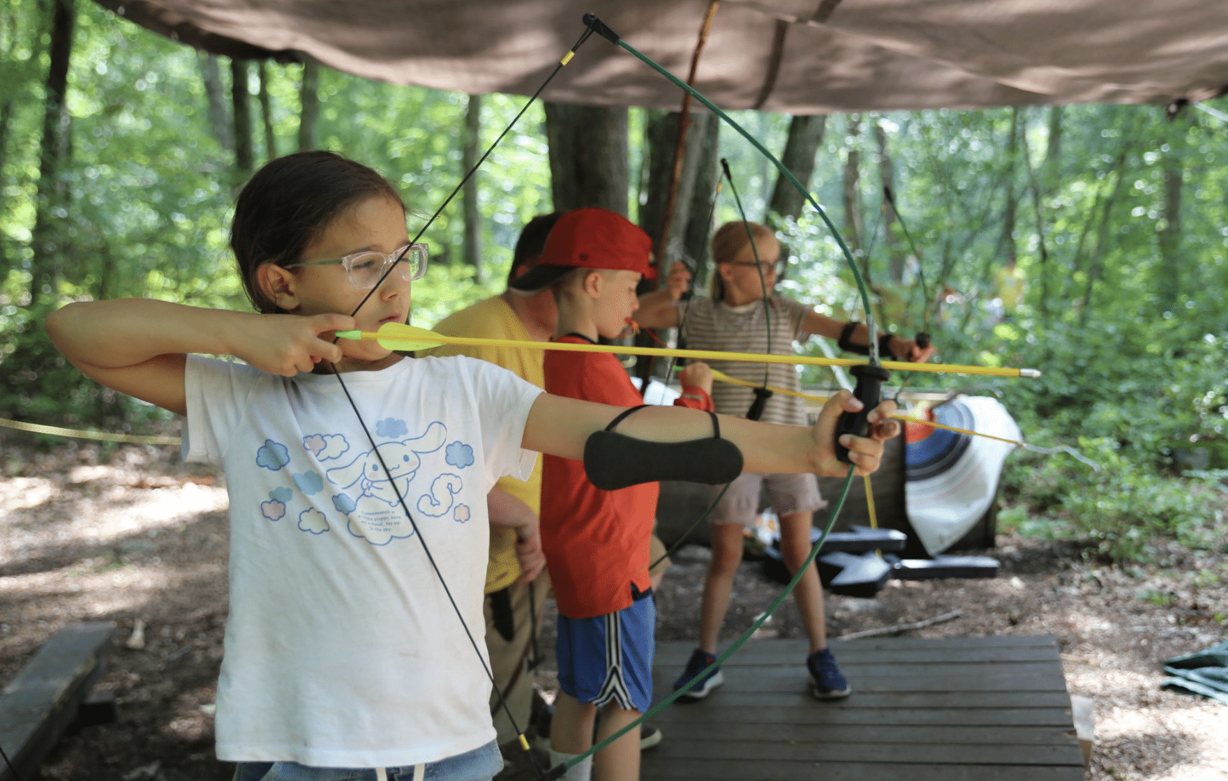 campers participating in archery
