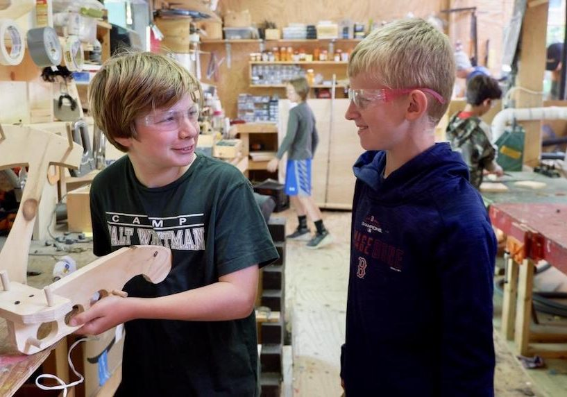 two young boys participating in wood shop