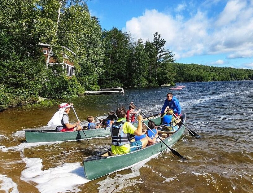 campers at summer camp in canoes