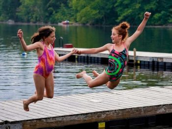 campers jumping off the dock