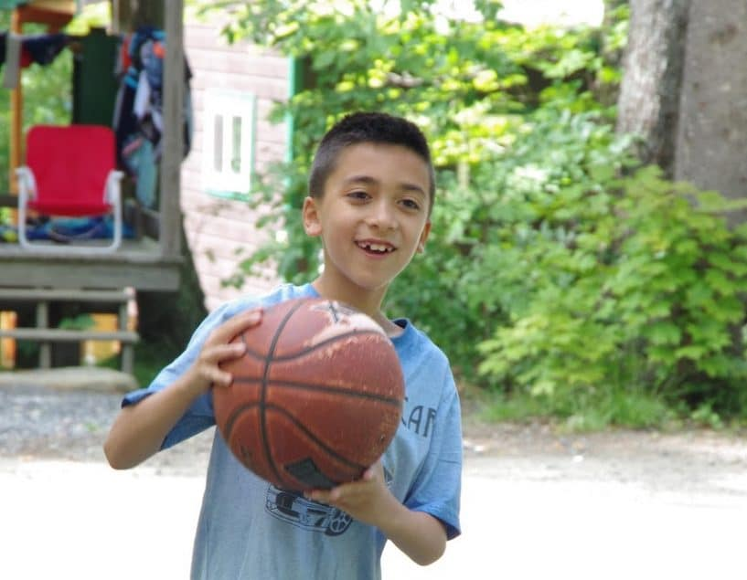 Boy playing with a basketball